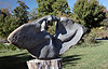 """Antelope Changes into Butterfly,<br /> Tapfuma Gutsa, 1988 Opal stone.<br /> <br /> """"Membwe, the young antelope, is pursued by hunters.  At the last moment, she metamorphoses into a butterfly and flies to safety.""""<br /> <br /> This carving was, for me, very challenging to interpret.  But it exhibits a wide range of surface detail that is worth viewing in some of the larger versions of this photo.<br /> <br /> 'Chapungu'  exhibit, Powell Gardens, Missouri"""