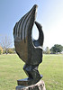 """""""Joyful Moments"""", rear view.<br /> <br /> I'm not sure there is a true front and back in this sculpture.  This view, with its stylized wing feathers, helps one make sense of a somewhat confusing carving.<br /> <br /> 'Chapungu'  exhibit, Powell Gardens, Missouri"""