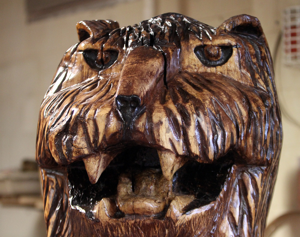 . Head of the lion that Chelmsford High senior Felix Huang carved from a section of the purple beech that had to be cut down on Chelmsford Town Common in 2013. (SUN/Julia Malakie)