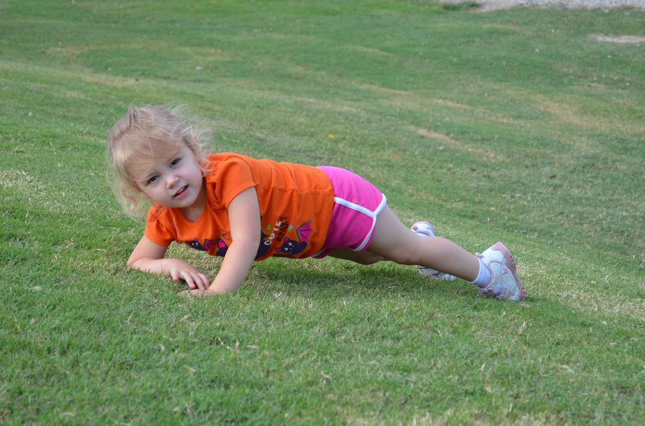 Laney playing on the grassy hill