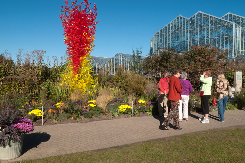 People were buzzing like bees around each Chihuly installation.  Who can blame them?<br /> <br /> Dale Chihuly, artist.<br /> Citron Green and Red Tower, 1998<br /> Glass and Stainless Steel<br /> <br /> Frederik Meijer Gardens,<br /> Grand Rapids, Michigan<br /> October 7, 2010.