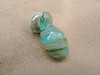 This lampwork mini-vessel is about 2.7 cm long by about 1.5 cm wide. Created with copper green glass, fine silver foil, and transparent aqua glass, this vessel shows the sparkle of the foil under the aqua glass and swirls of metallic luster.