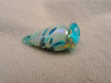 This lampwork mini-vessel is about 2.7 cm long by about 1.2 cm wide. Created with transparent aqua blue glass, fine silver foil, and Double Helix reactive frit, this mini-vessel has a lovely metallic shimmer.