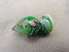 This lampwork mini-vessel is about 2.8 cm long by about 1.5 cm wide. Created with opaque dark ivory glass, fine silver foil, and transparent green glass, this mini-vessel displays lovely depth and sparkle.