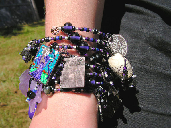 Custom order art charm braclet - celebrating the ancient triple goddess Hecate. Includes 20 of my own mixed media art charms, 14 pewter charms, loads of Swarovski crystals, and 38 of my own lampwork beads.