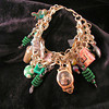 Green and brass mixed media steampunk artcharm bracelet. Features mixed media artcharms made by Peg Krzyzewski and Christine Hansen, and lampwork beads by Christine Hansen.