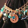 Aqua/turquoise and brass mixed media artcharm bracelet. Features mixed media artcharms made by Peg Krzyzewski and Christine Hansen, and lampwork beads by Christine Hansen.