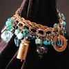 Aqua/turquoise and brass mixed media artcharm bracelet, detail.