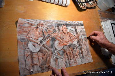 Chuck Calhoun working on drawing of Bobby Donaldson and Rusty Barkley at the Double Door