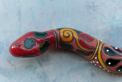 red ceramic snake