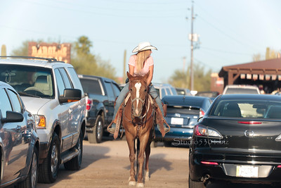 cowgirl on horse parking attendant