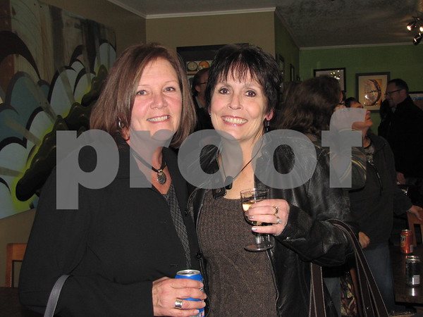 Janet Wiss and Sara O'Leary at Bob Wood's photo exhibit.