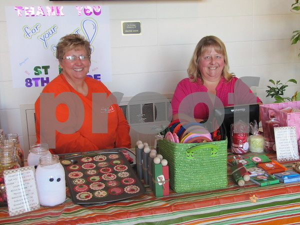 Janel Bothe and Robyn Kratz greeted visitors to the Community Artist Sale with a bake sale.