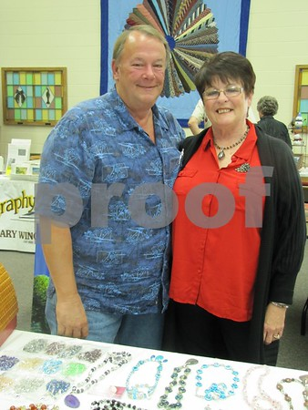 Ed and Carol Archer at the their booth.  Ed creates unique bird houses, and Carol creates jewelry.