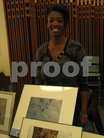 Qunetta McCaleb with some of her beautiful photographs.
