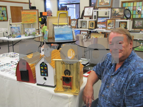 Ed Archer with some of his unique bird house creations.