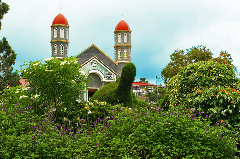 There are more than 100 topiaries at the Church of San Rafael in Zarcero, Costa Rica. They take on many shapes — a dinosaur, an octopus and Christ carrying a cross. The man who created the park 40 years ago, Evangelista Blanco Brenes, still trims the bushes