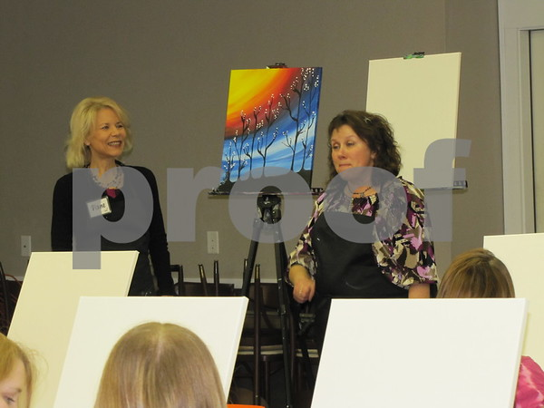Christy Mader, Event Coordinator (right) gives some general instructions to the class before the artist, Diane O'Hern leads the class through the process.