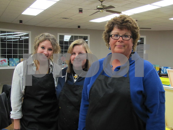 Jill Rosendahl, Sarah Nelson, and Carla Nelson pose before the painting begins.