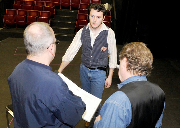 Director John Thornberry, of Longmont, left, goes over changes with James O'Hagan-Murphy, of Denver, and Chris Kendall, of Denver, on Saturday, Feb. 5, during a rehearsal for Crime and Punishment at The Dairy Center For the Arts in Boulder. <br /> Jeremy Papasso/ Camera