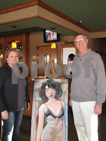 Jennifer Condon, the Dean of Liberal Arts and Sciences at ICCC, and art instructor Dick Hanson stand beside a student's painting displayed at the Art Expose' held at Willow Ridge Restaurant.