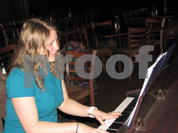 Shelby Janssen provided music for the Art Expose' of ICCC students at the Willow Ridge Restaurant.