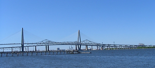This is the old and the new bridge over the Charleston, SC harbor.  The old bridge shows the spans on the left and right the new bridge is the taller spans with the cables.