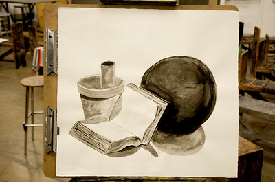 A paper towel tube, a flower pot, a book (with no cover) and a bowling ball.  Typical things you see lying around all the time, right?   This is my VERY FIRST PAINTING EVER people.. so stop laughing at me....  This was done with only Black Acrylic paint - mixing it with water to get different values.