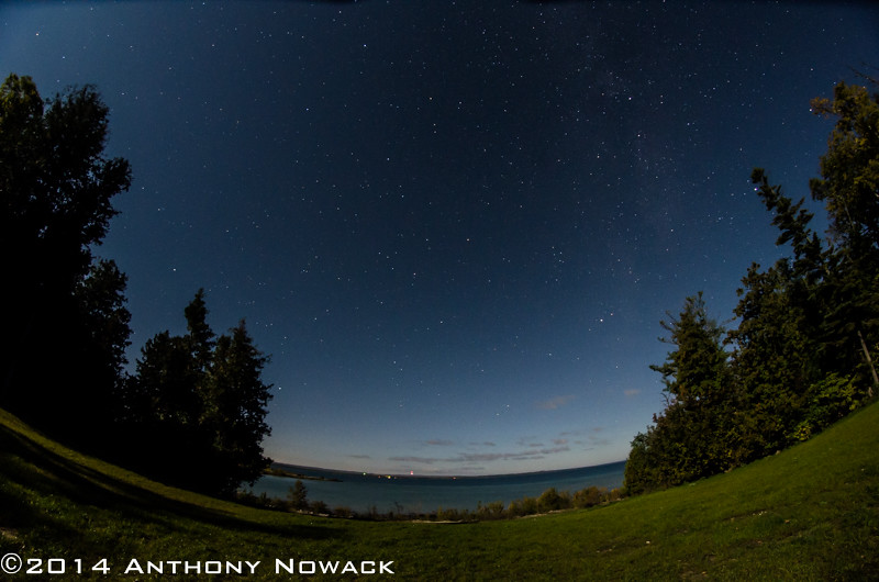 View out over the lake from the clearing. Brighter corner on the upper left is from the moon. Exposure 20 sec. at F5.6, ISO 1250. Rokinon 8mm Fisheye.