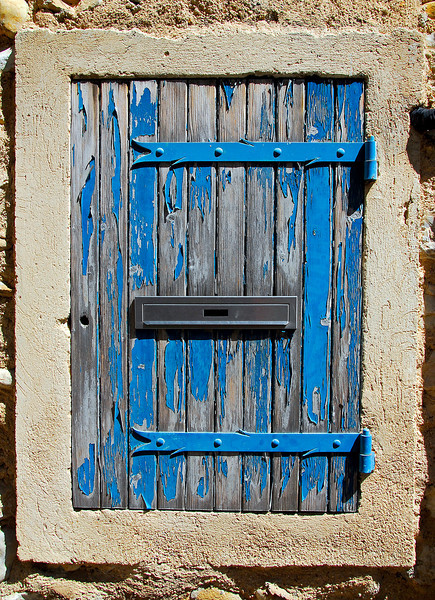 Blue door with letter slot, France.