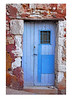 Blue door with rosey stone work, France.