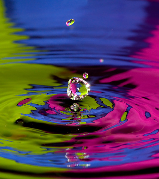 a water droplet sparkles just before impact