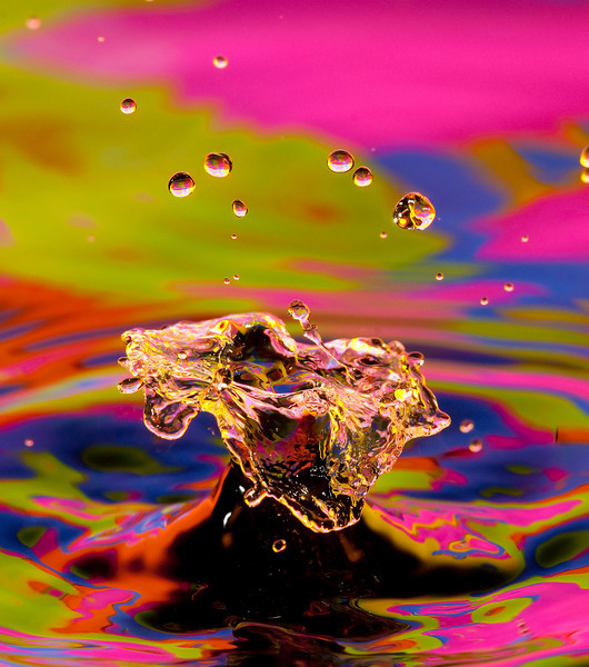 water drop explosion with brightly colored background
