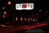Keri Rosebraugh, J. Macaya &  Treiops Treyfid billboard at 22nd St. and Broadway, Oakland, CA.