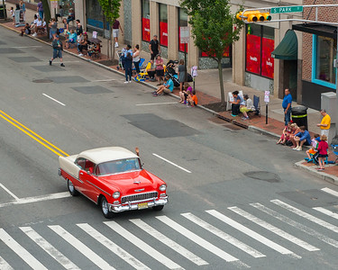 """WAVE FROM THE RED CAR"" 56.0mm, f.7.1, ISO 640, 1/800, Nikon D700, Nikkor 24-70mm Date: July 4, 2015 Event: 2015 4th of July Parade"