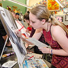 Madison Simon works on some live art during the Evening with the Arts at Oakmont on Friday evening. SENTINEL & ENTERPRISE / Ashley Green