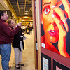 Patrick and Karen McInnis take a closer look at the art on display during the Evening with the Arts at Oakmont on Friday evening. SENTINEL & ENTERPRISE / Ashley Green