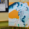 """Interactive art on display during the Evening with the Arts at Oakmont on Friday evening. The colors in this painting are inverted, and by """"inverting colors"""" on the screen of your iPhone, you can see the painting how it is meant to be viewed. SENTINEL & ENTERPRISE / Ashley Green"""