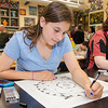 9th grader Olivia Renda works on some live art during the Evening with the Arts at Oakmont on Friday evening. SENTINEL & ENTERPRISE / Ashley Green