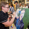 Austin Evans works on a painting during the Evening with the Arts at Oakmont on Friday evening. SENTINEL & ENTERPRISE / Ashley Green