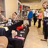 Guests look at art during the Evening with the Arts at Oakmont on Friday evening. SENTINEL & ENTERPRISE / Ashley Green