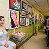 Senior Adrienne Mercier shows off her art during the Evening with the Arts at Oakmont on Friday evening. SENTINEL & ENTERPRISE / Ashley Green