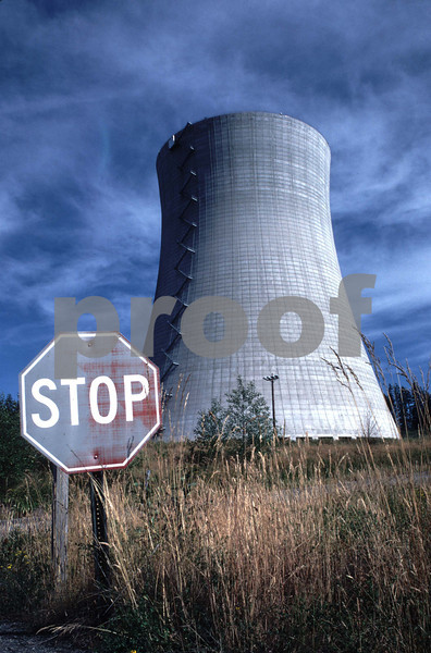 A stop sign near the Satsop Nuclear Plant cooling tower....a project that was never completed...near Elma, WA.