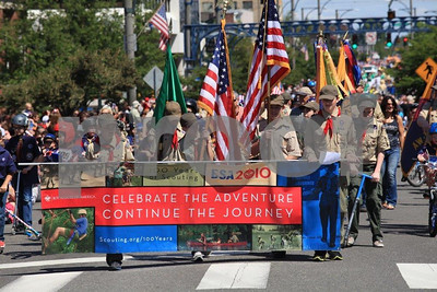 Boy Scouts celebrate 100 years by carry their flags at a Fourth of July Parade. WA