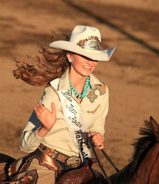 Miss Teem Rodeo rides a parade lap at a local rodeo in Shelton, WA.