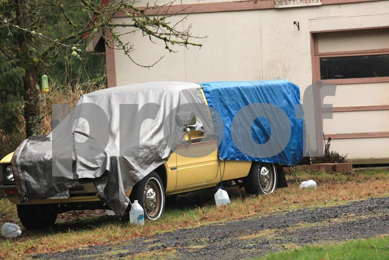 When it rains it pours and Americans tend to cover their prized possessions with plastic tarps - blue is preferred.  WA