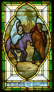"""I recently heard somebody at church refer to this as the """"purple donkey"""" window.  I took another look at the window and said to myself, """"Oh yeah..that's purple!""""  Maybe Povey Bros. had some excess inventory of purple glass that they wanted to get rid of.  (Although it is more likely that the color is painted on, not in the glass.)"""