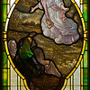 "The PoveyBrothers windows in the sanctuary consist of 2 main groups.  The first is a set of 12 ""medallion style"" windows ranging along the walls of the lower part of the sanctuary and in the narthex.  They depict scenes from the life of Christ.  In this one the angel is proclaiming the news of the birth of Jesus to the shepherds.  If you look at it close up you will see places where the paint is wearing off."