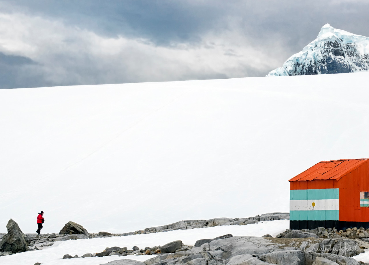 """""""Shelter from the Storm""""  Wiencke Island, Antarctica.  An Argentinian emergency supply depot offers protection from the elements."""