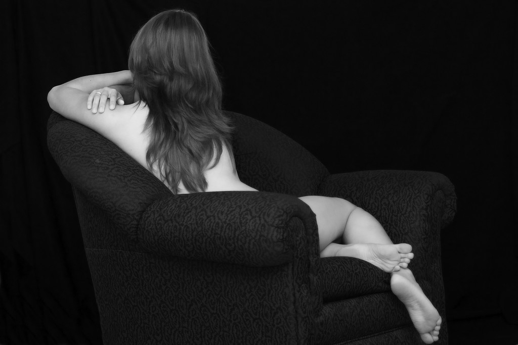 Beautiful woman in couch. fine art nudes of the female form